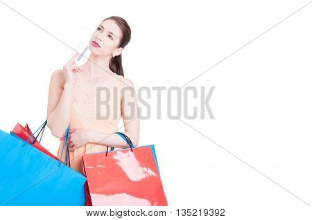 Woman Holding Shopping Bags And Credit Card Acting Thoughtful