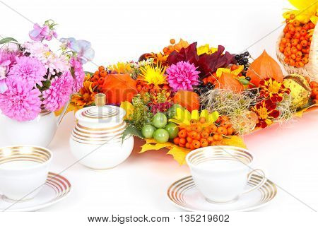 autumn fruits with candle, flowers and coffee services