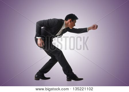 Asian business man posing tug of war, full length portrait isolated