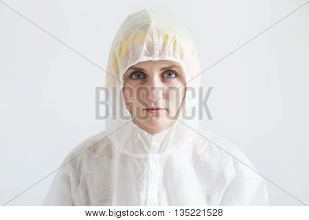 Woman in white protective clothes. Woman scientist or farm worker concept