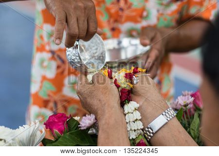 Thai people celebrate Songkran the new year water festival by giving garlands to their seniors and asked for blessings