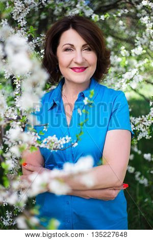 Middle Aged Woman In Summer Garden