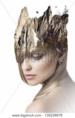 Double exposure portrait of attractive woman combined with mountains on her head