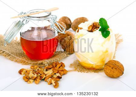 Yogurt honey and nuts against a white background