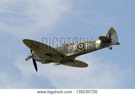 STANDEN, UK - AUGUST 15: A vintage WW2 Spitfire exits the flight line having passed over Headcorn aerodrome during the Combined Ops military show on August 15, 2015 in Standen