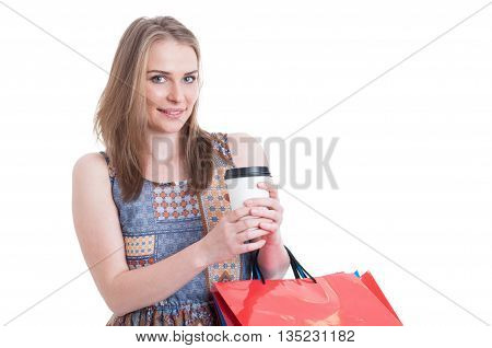 Young Attractive Shopper Holding Shopping Bags And Take Away Coffee