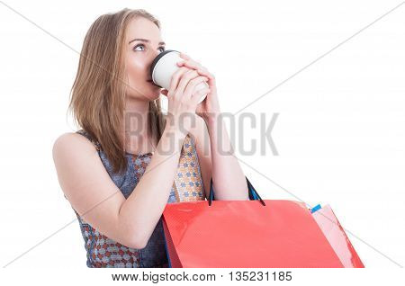Portrait Of Young Customer Female Drinking Coffee While Doing Shopping