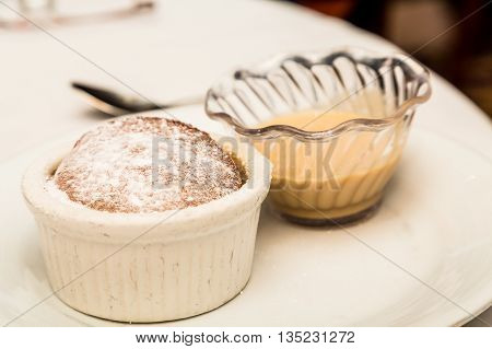 Souffle with Powdered Sugar and Cream Sauce in Ramekins