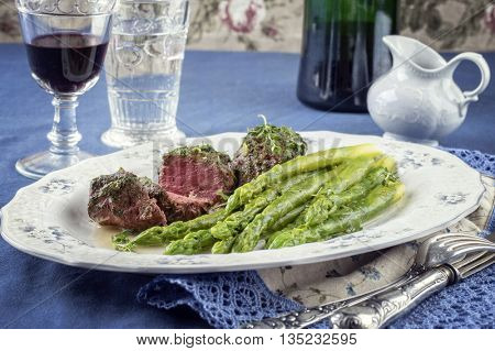 Medaillon with Green Asparagus on Plate
