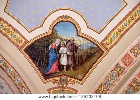 STITAR, CROATIA - AUGUST 27: Holy Family, fresco in the church of Saint Matthew in Stitar, Croatia on August 27, 2015