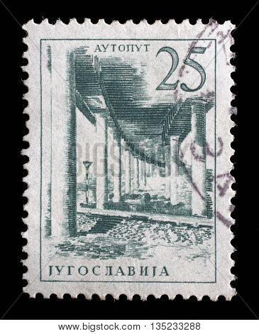 ZAGREB, CROATIA - JUNE 14: Stamp printed in Yugoslavia shows a Ljubljana - Zagreb motor road, from series Industrial Progress, circa 1958, on June 14, 2014, Zagreb, Croatia