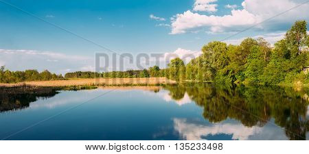 River Landscape With Clouds Reflected In The Water. Sunny Summer Day. Panorama. Nobody.