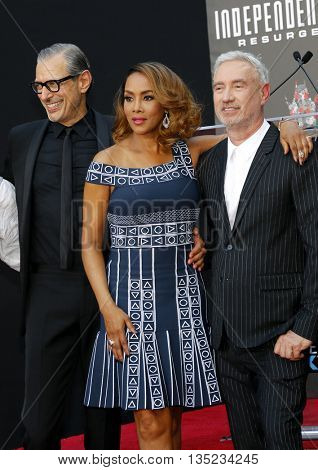 Jeff Goldblum, Roland Emmerich and Viveca A. Fox at the Roland Emmerich Hand And Footprint Ceremony held at the TCL Chinese Theatre in Hollywood, USA on June 20, 2016.