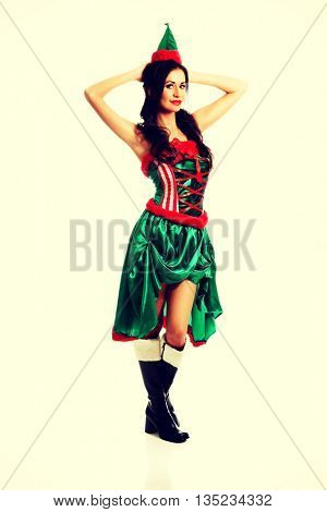 Smiling woman wearing elf clothes