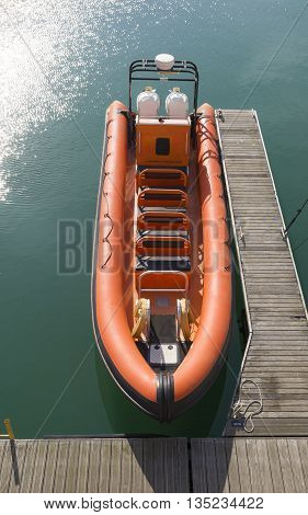orange inflatable boat in the Brighton marina for touristic trips