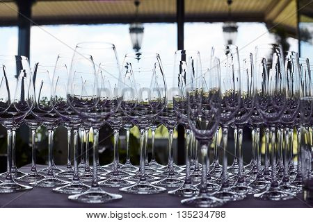 Set of glasses for alcoholic drinks on table