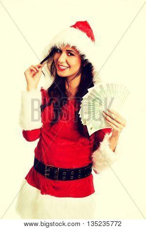 Santa woman holding a clip of polish money