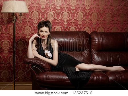 Young beautiful actress in the dark interior