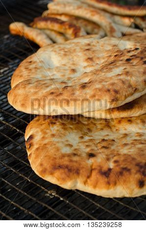 Hot and fresh baked flatbread on a grill for a picnic
