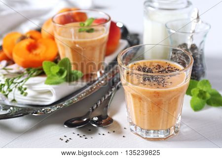 Apricot smoothie milk, chia seeds and fruits