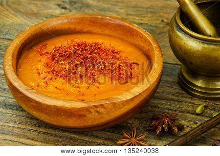 Carrot Cream Soup with Saffron Diet Food Studio Photo