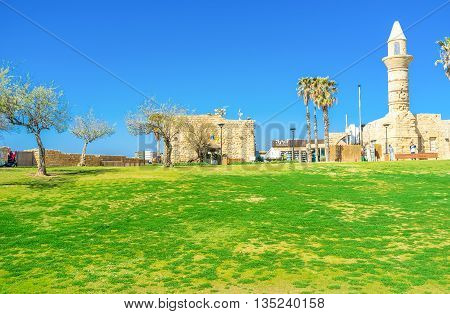 CAESARIA ISRAEL - MAY 19 2016: The archaeological site contains the ancient Roman ruins and remains of the Middle Ages such as the scenic stone mosque located at harbor on May 19 in Caesaria.