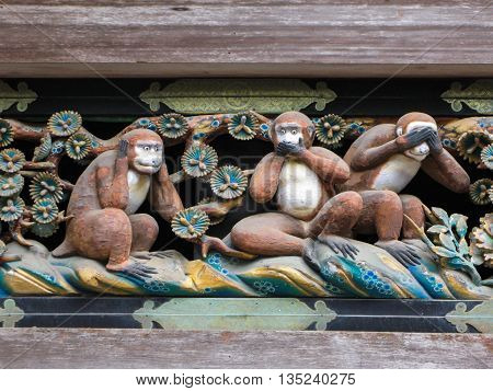 Nikko, Tochigi, Japan - May 05, 2009: Three Wise Monkeys (Hear No Evil, Speak No Evil, See No Evil). Famous wooden carving   above the gate to the sacred stables at  the Toshogu sanctuary in Nikko.