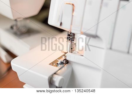 Overlock Sewing Machine On The Workplace