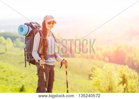 Young Backpacker Woman Standing At The Top Of Hill