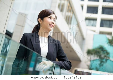 Asian Businesswoman standing at outdoor