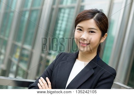 Young Businesswoman stanidng outside