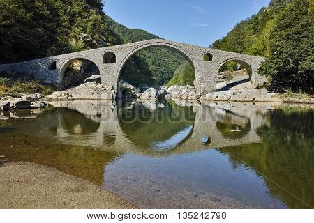 Amazing Reflection of Devil's Bridge in Arda river and Rhodopes mountain, Kardzhali Region, Bulgaria