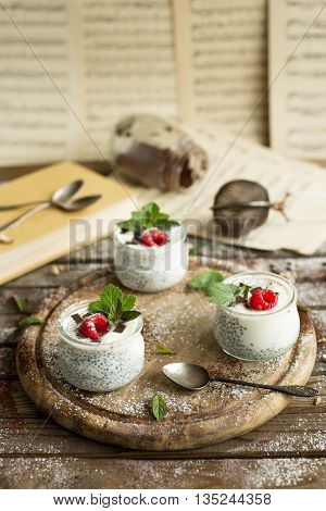 Chia seed pudding with raspberries chocolate and mint Healthy vegan chia pudding Vertical shooting