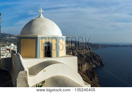 Orthodox church in town of Firostefani and panorama Santorini island, Thira, Cyclades, Greece