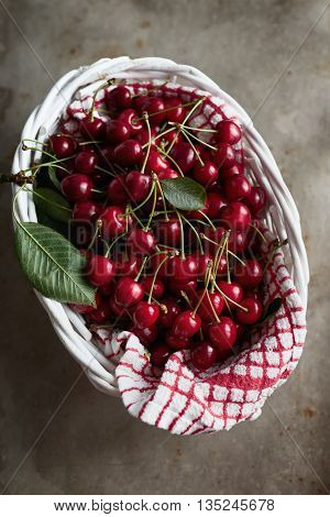 A basket of freshly picked cherries