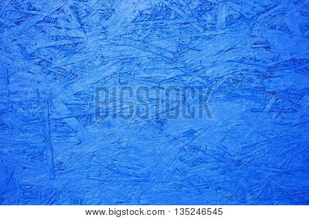 oriented strand board background OSB blue texture