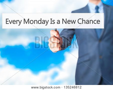 Every Monday Is A New Chance - Businessman Hand Holding Sign