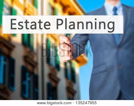 Estate Planning - Businessman Hand Holding Sign