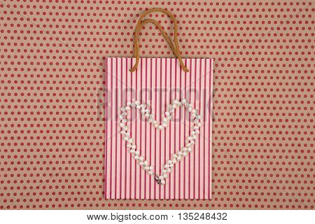 Celebratory Concept - Handmade Striped Shopping Bag Of Craft Paper, Gift Bags And Women's Pearl Jewe