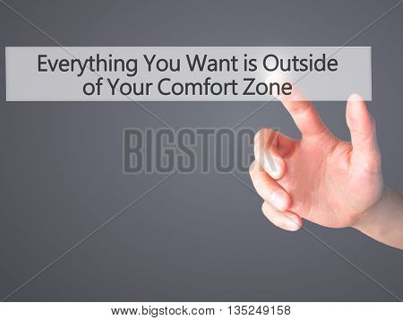 Everything You Want Is Outside Of Your Comfort Zone - Hand Pressing A Button On Blurred Background C