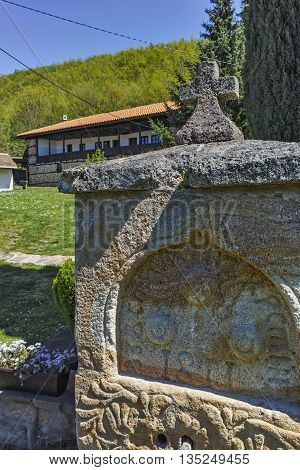 Stone fountain and church in  Temski monastery St. George, Pirot Region, Republic of Serbia