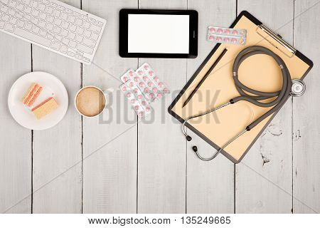 Workplace Of Doctor - Stethoscope, Pills, Clipboard, Tablet Pc, Keyboard Of Computer, Cup Of Coffee