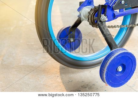 Closeup of spinning children bicycle chain wheel.