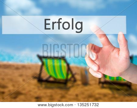 Erfolg (success) - Hand Pressing A Button On Blurred Background Concept On Visual Screen.