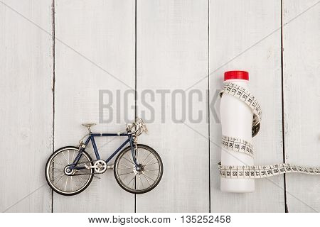 Sport Concept -  Bicycle Model, Bottle Of Water And Centimeter Tape