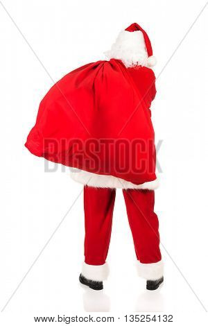 Santa Claus carrying bag with presents