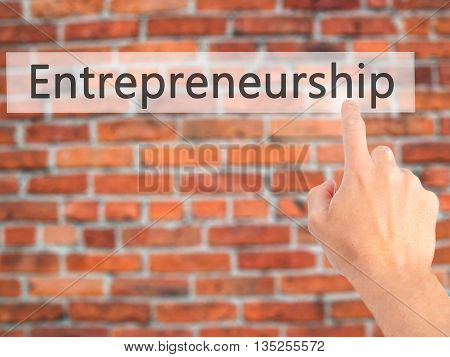 Entrepreneurship - Hand Pressing A Button On Blurred Background Concept On Visual Screen.