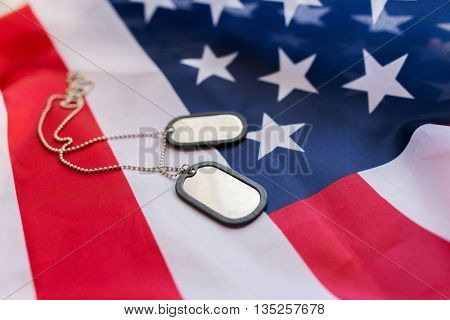military forces, military service, patriotism and nationalism concept - close up of american flag and soldiers badges