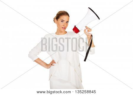 Young businesswoman holding megaphone