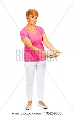 Senior woman holding few tablets package